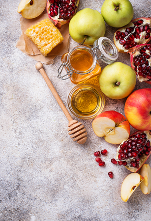 Honey, apple and pomegranate for Rosh Hashana, jewish New Year. Selective focus Stock Photo