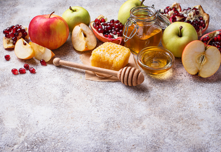 Honey, apple and pomegranate for Rosh Hashana, jewish New Year. Selective focus