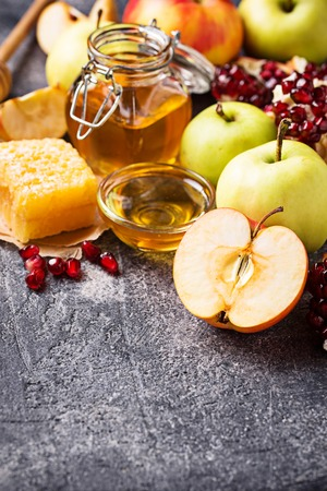 Honey, apple and pomegranate for Rosh Hashana, jewish New Year. Selective focus Stock Photo