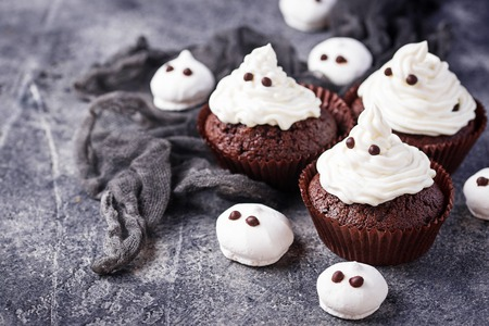 Cupcake in shape of ghost. Halloween treat for children party Stock Photo