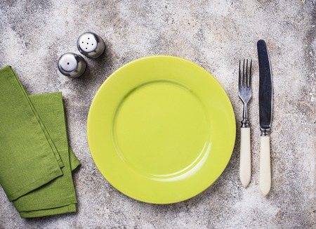 Empty green plate on concrete table