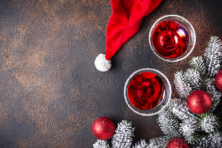 Christmas festive cocktail red martini on dark background 스톡 콘텐츠