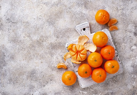 Fresh ripe tangerines on light background. Top view