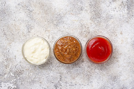 Set of different sauces: mustard, ketchup, mayonnaise on light background. Tio view Banco de Imagens - 113142864
