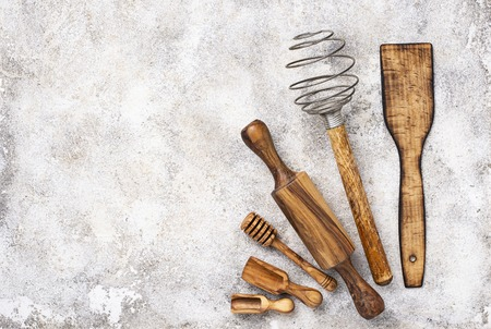 Wooden kitchen utensils from olive wood. Top view