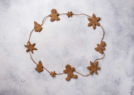 Winter Christmas composition with gingerbread cookies on white background