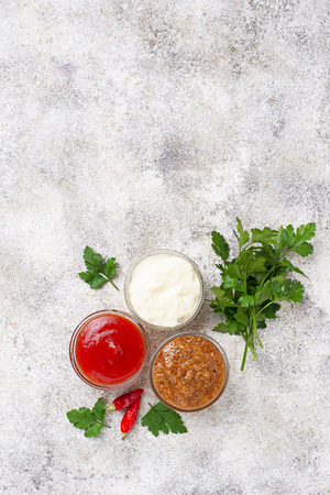 Set of different sauces: mustard, ketchup, mayonnaise Stock Photo