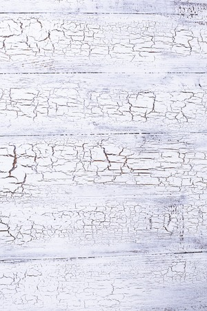 Old rustic crackle white wooden background
