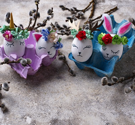 Easter handmade eggs in shape of bunny, cat, unicorn and deer Standard-Bild