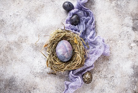 Easter painted chicken eggs with stone or marble effect