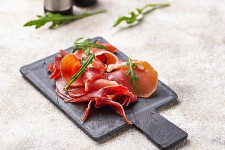 Traditional Spanish cured meat jamon Фото со стока