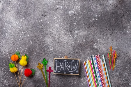 Items for summer party. Paper straws and toppers