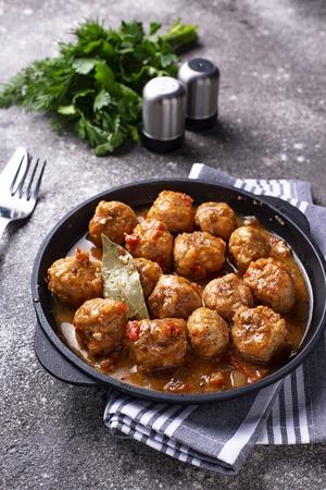 Homemade meatballs with tomato sauce in fry pan Banco de Imagens