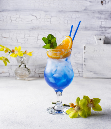 Blue cocktail drink with ice, mint  and orange 写真素材