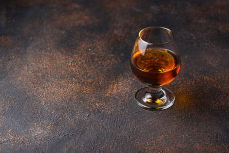 Glass of cognac or whiskey. Strong alcoholic drink Imagens - 122767553