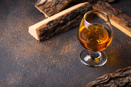Glass of cognac or whiskey. Imagens