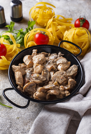 Stewed chicken fillet with mushrooms and cream sauce