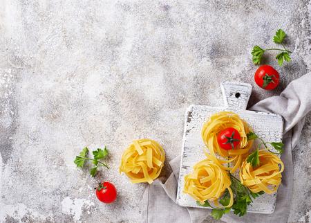 Raw uncooked homemade pasta tagliatelle or fettuccine Stock Photo - 122851073