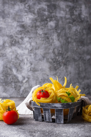 Raw uncooked homemade pasta tagliatelle or fettuccine