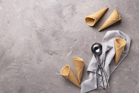 Scoop and empty waffle cones for ice cream Stockfoto