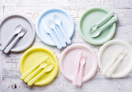 Colorful plastic dishes for summer party or picnic