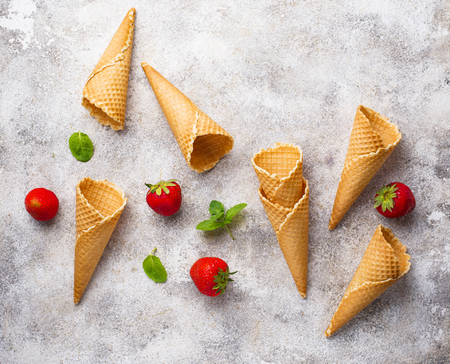Empty waffle cones for ice cream and strawberry