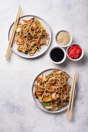 Traditional Asian noodles with shrimps and vegetables