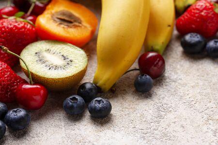 Fruits and berries summer background. Vitamins concept Reklamní fotografie