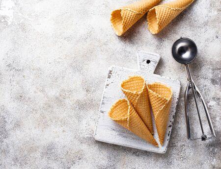 Scoop and empty waffle cones for ice cream Banco de Imagens