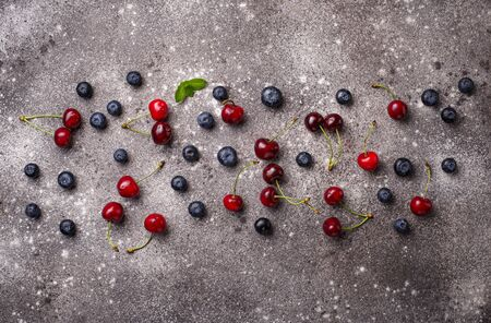 Summer background with different berries. Vitamins concept