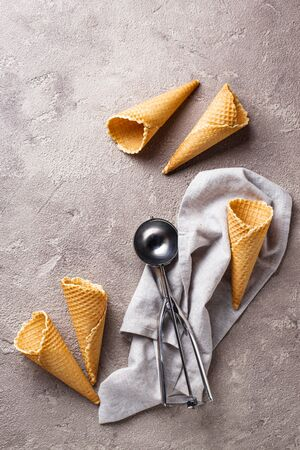 Scoop and empty waffle cones for ice cream