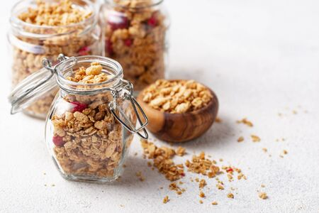 Homemade granola with dried berry in jars