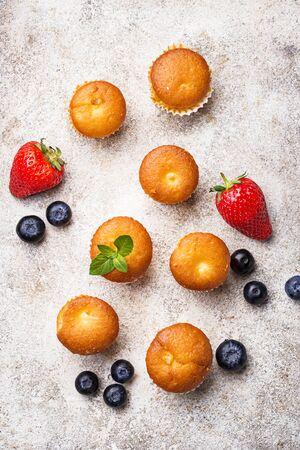 Summer mini cupcakes with strawberry and blueberry