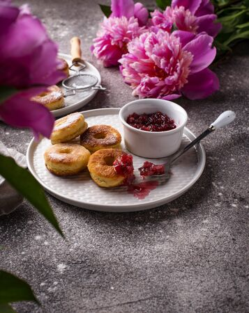 Homemade sweet roasted donuts with rose jam
