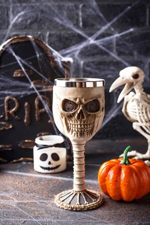 Halloween background with bird skeleton and spider web Фото со стока