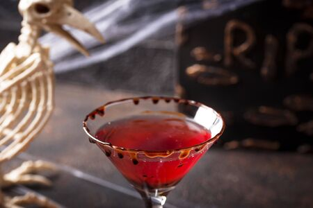Halloweens drink red martini cocktail with chocolate rim
