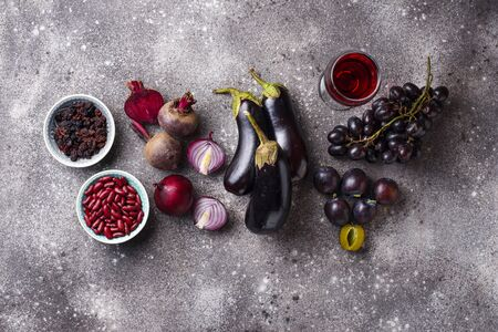 Collection of purple food. Fruits, vegetables, beans and wine Archivio Fotografico - 127747554