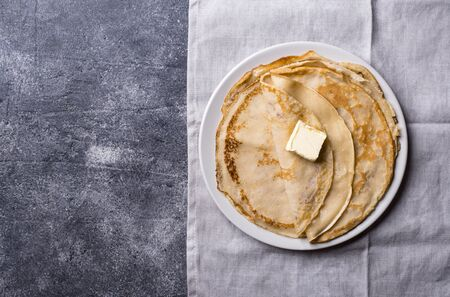 Homemade pancakes crepes on dark stone background