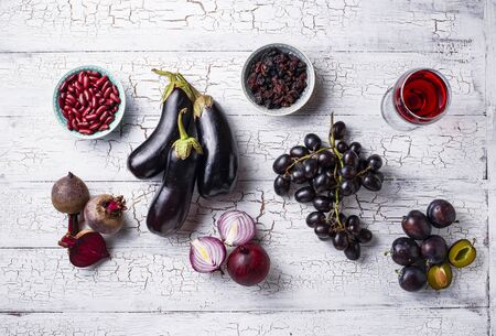 Collection of purple food. Fruits, vegetables, beans and wine