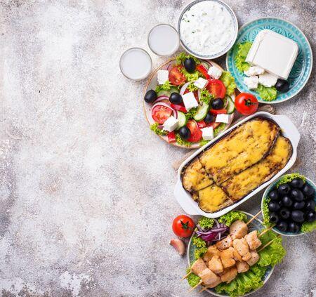 Assortment of traditional greek dishes. Salad, tzatziki, feta, meze, souvlaki and moussaka