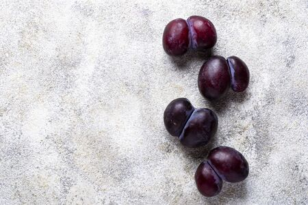 Ugly plums. Abnormal organic fruit