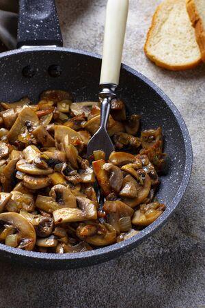 Roasted mushrooms champignons in pan
