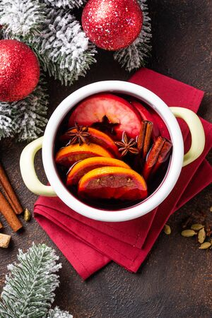 Cooking Christmas hot mulled wine in pan