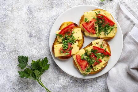 Grilled toast with tomato and cheese