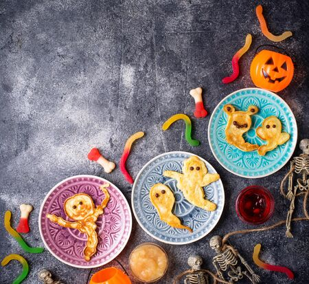 Halloween creative treat ghost pancakes. Food for children party Фото со стока