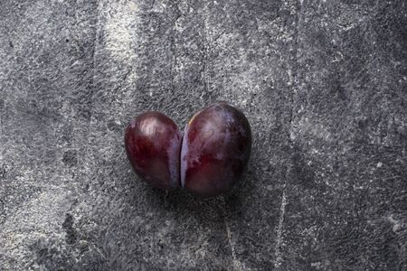 Oddly shaped plums. Abnormal organic conjoined fruit in shape of heart or butterfly