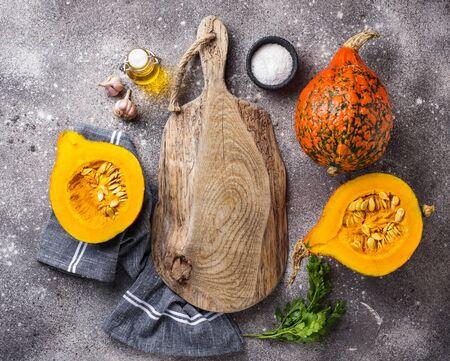 Halves of hokkaido pumpkin with spices Фото со стока