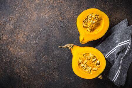 Dissected raw hokkaido pumpkin with seeds