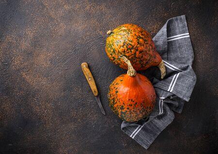 Raw hokkaido pumpkins on rusty background