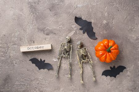 Halloween background with skeleton and bat